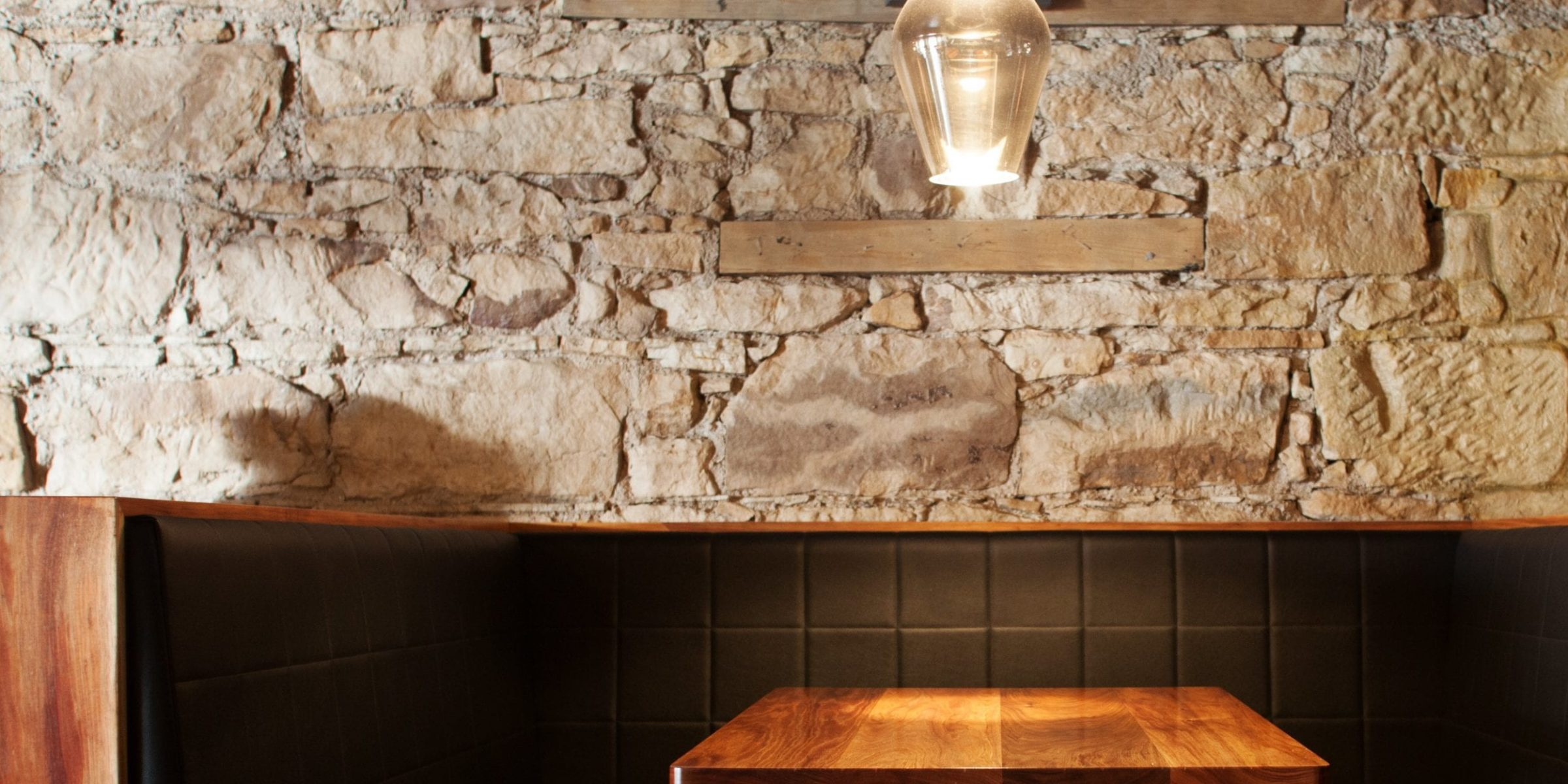 Blackwood timber tabletops provide a contrast to the convict sandstone walls