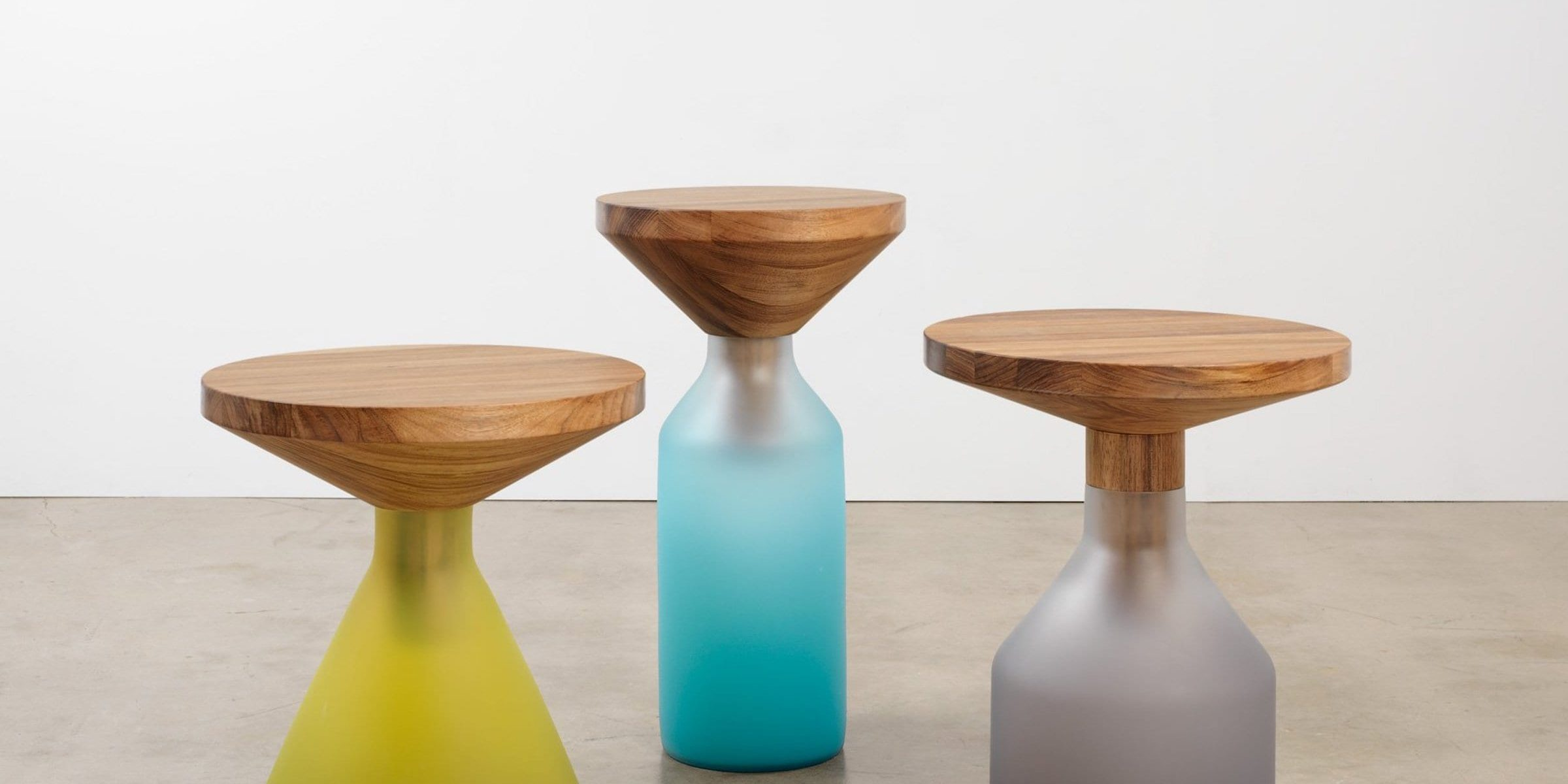 A series of congruent side tables, a collaboration from Adelaide's Jam Factory between Goulder and glass artist Liam Fleming